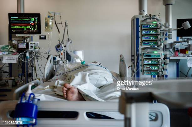 An unconscious COVID19 patient lays on a bed inside the Intensive Care Unit for COVID 19 patients of Krakow's University Hospital on April 18 2020 in...
