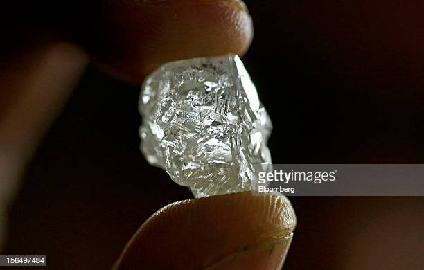 An uncut 25 carat diamond is displayed in this arranged photograph at the Shrenuj Botswana Ltd sightholder office in Gaborone Botswana on Thursday...