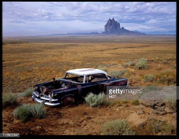 An undated file photo of a car in the desert in the four corners area of New Mexico Shiprock in distance They add roughly $200 to new car costs but...