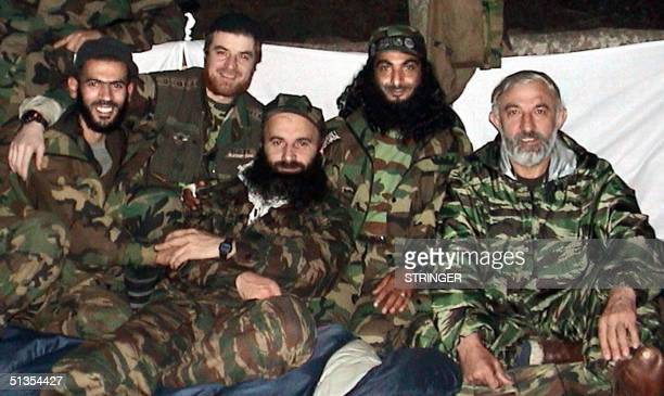 An undated file picture shows Chechen rebel leaders Shamil Basayev , Aslan Maskhadov , Abu Al Valid and two unindetified rebels photographed in a...