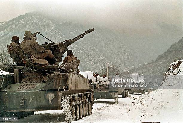 An undated file picture shows Russian soldiers atop an APC taking their position near the village of Shatoy in Chechnya Military bases are fortified...
