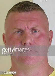 An undated handout image provided by Northumbria Police, released July 6 of Raoul Moat, 37. Police hunting Moat have set a two mile exclusion zone...