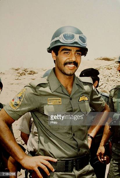 An undated photo of Uday Saddam Hussein shows him wearing a military uniform It was found April 12 2003 in his Baghdad Iraq palace Unconfirmed...