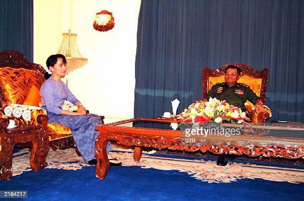 An undated photograph splashed across the front page of the state-run New Light of Myanmar shows democracy leader Aung Sn Suu Kyi sitting at the...