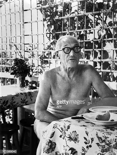 An undated picture of French architect Le Corbusier having a meal at a small restaurant L'Etoile des mers' next to his 'cabanon' a tiny bolthole...