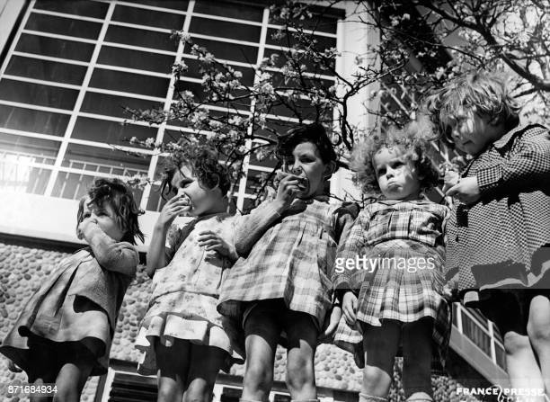 An undated picture probably taken in the 1930s shows French little kindergarten children having their midafternoon snack in in the garden of the...