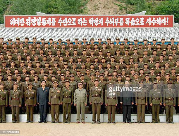 An undated picture releaed from Korean Central News Agency on August 1 shows North Korean leader Kim Jong Il posing with soldiers of Korean People's...
