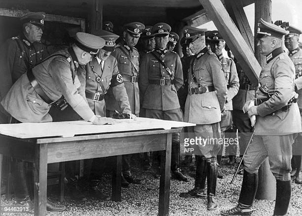 An undated picture shows Chancellor Adolf Hitler and his General Staff members consulting a map German during military manoeuvres AFP PHOTO
