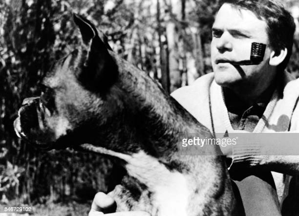 An undated picture shows Czech writer Milan Kundera posing with his dog in Prague Novelist born in Brno Czech Republic Kundera lectured in...