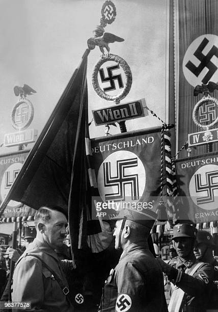 An undated picture shows German Nazi Chancellor Adolf Hitler talking to a soldier during a military ceremony in Vienna after the Anschluss From 1938...