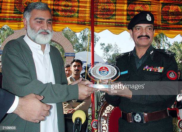 An undated picture shows Saeed Khan Inspector General of police in North West Frontier Province and NWFP Chief Minister Akram Durrani posing for...