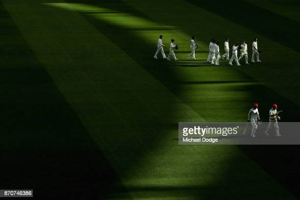An undefeated Callum Ferguson of South Australia walks off with Alex Carey at the end of day three of the Sheffield Shield match between Victoria and...