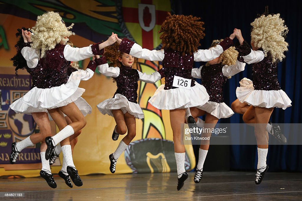 An under 11's dance group from the Fegan dance school in Leinster, Ireland, performs a Ceili dance during the World Irish Dance Championship on April 14, 2014 in London, England. The 44th World Irish Dance Championship is currently running at London's Hilton London Metropole hotel, and will host approximately 5,000 dancers competing in solo, Ceili, modern figure choreography and dance drama categories during the week long event.