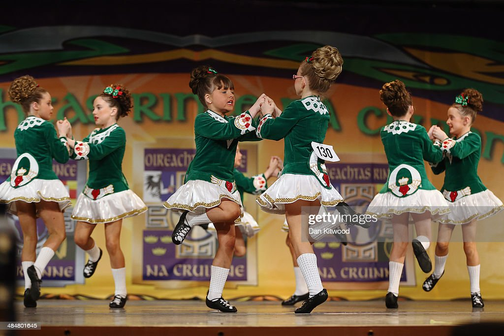 An under 11's dance group from the Fleming Ball dance school in Munster, Ireland, performs a Ceili dance during the World Irish Dance Championship on April 14, 2014 in London, England. The 44th World Irish Dance Championship is currently running at London's Hilton London Metropole hotel, and will host approximately 5,000 dancers competing in solo, Ceili, modern figure choreography and dance drama categories during the week long event.