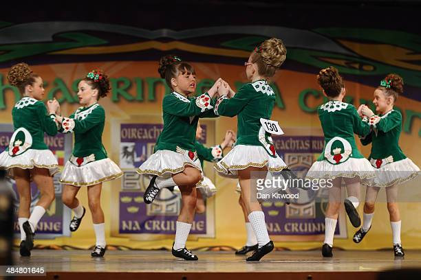 An under 11's dance group from the Fleming Ball dance school in Munster Ireland performs a Ceili dance during the World Irish Dance Championship on...