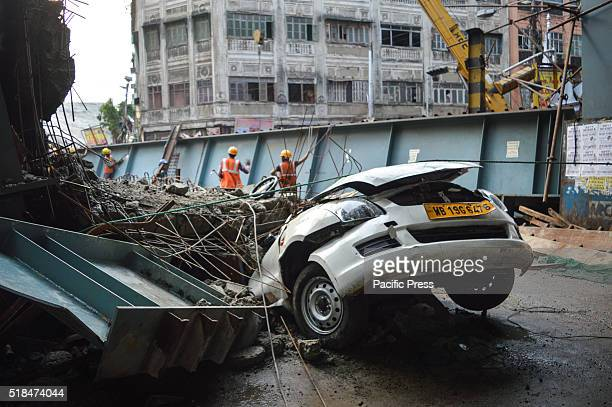 An underconstruction flyover collapsed in a congested Kolkata neighborhood killing at least 22 people and trapping hundreds underneath giant steel...