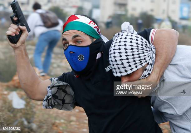 TOPSHOT An undercover Israeli policeman detains a Palestinian protestor during clashes following a demonstration in the West Bank city of Ramallah on...