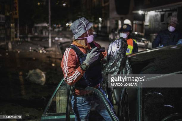 An undercover Johannesburg Metro Police Department officer checks the content of a suspect car in the Johannesburg CBD on March 27 2020 South Africa...