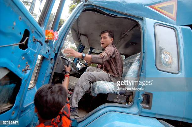 An undercover police man parks the truck used in the sex trafficking at the police station October 21 2005 in Kakarbhitta Nepal The truck is kept in...