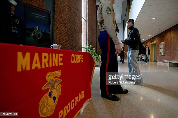 An undergraduate student listens to US Marine recruiter Staff Sergeant Tim Norris during a Marine recruiting presentation on campus at Rutgers...