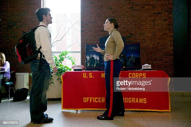 An undergraduate student speaks to US Marine recruiter Captain Sharon Dubow during a Marine recruiting presentation on campus at Rutgers University...