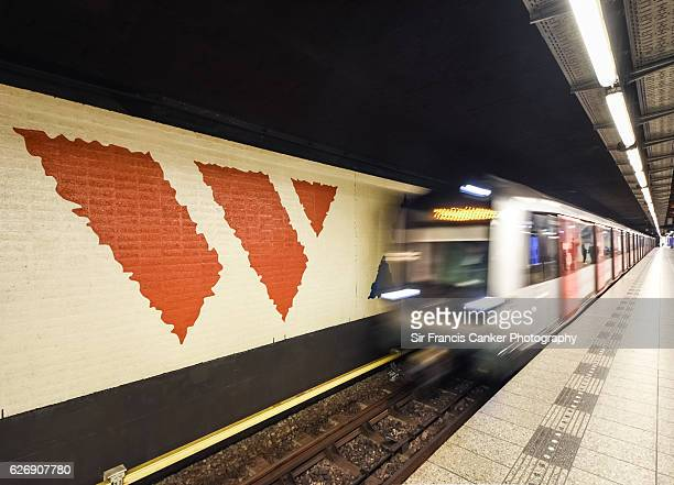 An underground train leaves a modern metro station with blurred motion in Amsterdam, the Netherlands
