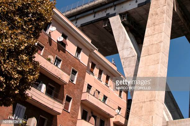 TOPSHOT An underneath view of the Morandi motorway bridge taken on August 16 2018 from Via Fillak two days after a section of the bridge collapsed...