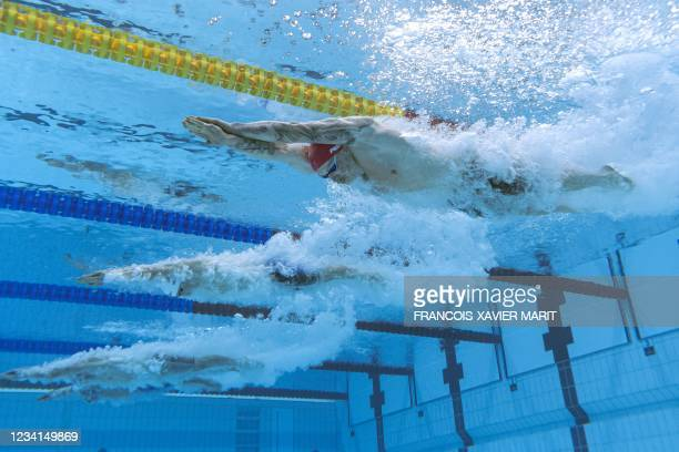 An underwater view shows Britain's Adam Peaty competing in a heat for the men's 100m breaststroke swimming event during the Tokyo 2020 Olympic Games...