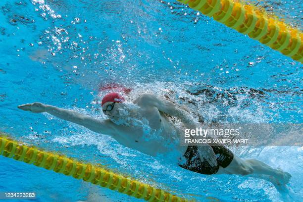 An underwater view shows Britain's Duncan Scott competing in the final of the men's 200m freestyle swimming event during the Tokyo 2020 Olympic Games...