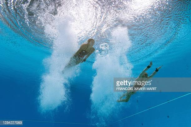 An underwater view shows Britain's Eden Cheng and Britain's Lois Toulson competing in the women's synchronised 10m platform diving final event during...