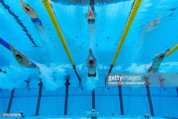An underwater view shows Bronze medallist Italy's Nicolo Martinenghi , Gold medallist Britain's Adam Peaty and Silver medallist Netherlands' Arno...