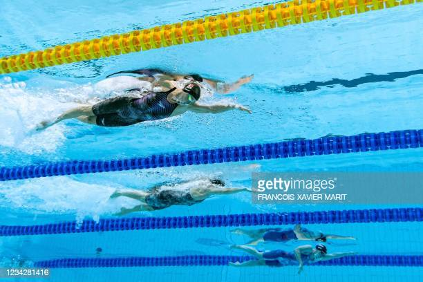 An underwater view shows Denmark's Pernille Blume Denmark's Signe Bro and USA's Erika Brown in a semi-final of the women's 100m freestyle swimming...