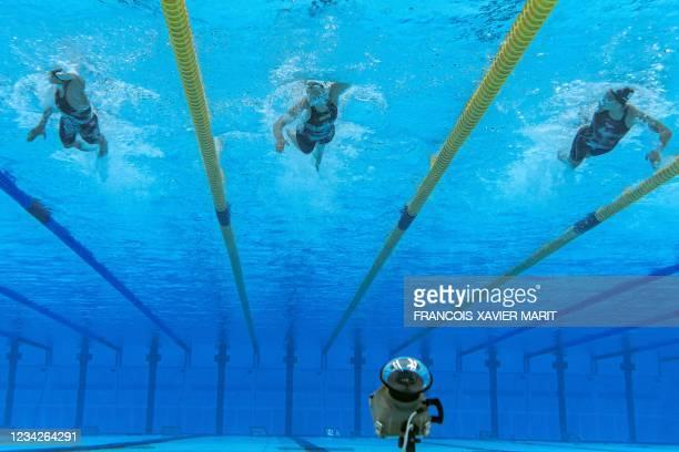 An underwater view shows Ecuador's Anicka Delgado , Egypt's Farida Osman and Cyprus' Kalia Antoniou in a heat for the women's 100m freestyle swimming...