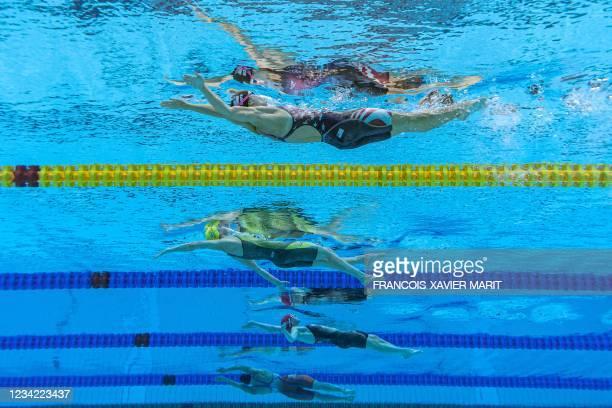 An underwater view shows USA's Regan Smith, Australia's Kaylee McKeown, Britain's Kathleen Dawson and Netherlands' Kira Toussaint competing in the...