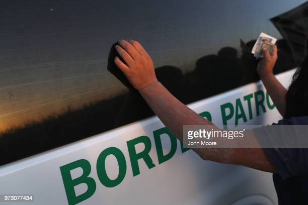 An undocumented immigrant is bodysearched by a US Border Patrol agent after being caught hiding in a sugarcane field near the USMexico Border on June...