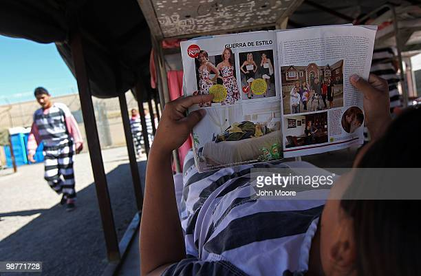 An undocumented immigrant reads on his bunk in the Maricopa County tent city jail on April 30 2010 in Phoenix Arizona Some 200 undocumented...