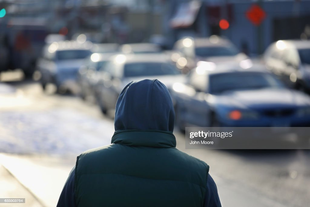 An undocumented immigrant waits for work along a city street on February 1, 2017 in Stamford, Connecticut. The city of Stamford has an official zone for employers to pick up day laborers, although many prefer to stand by nearby businesses for warmth and greater visibility to employers. Stamford, CT is located in Fairfield County, considered a 'sanctuary county' for not reporting undocumented immigrants to federal authorities.