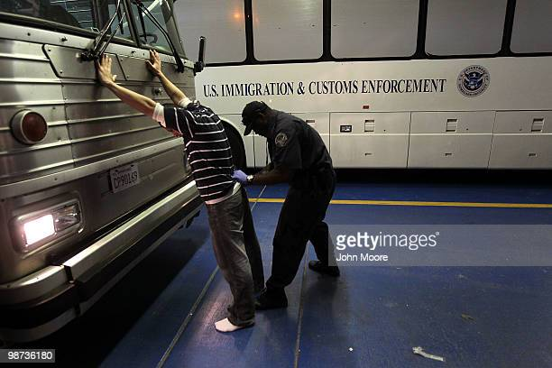 An undocumented Mexican immigrant is searched while being inprocessed at the Immigration and Customs Enforcement center on April 28 2010 in Phoenix...