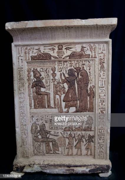 An unearthed stele is displayed during the official announcement of the discovery by an Egyptian archaeological mission of a new trove of treasures...