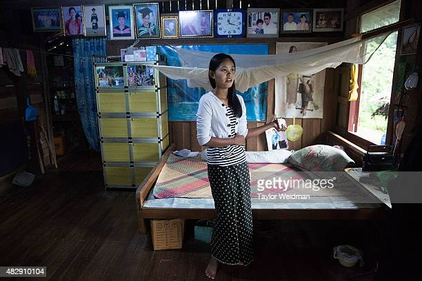 An unemployed Burmese woman stands in front of her bed in her home near the planned Dawei SEZ on August 4 2015 in Pantininn Myanmar The controversial...