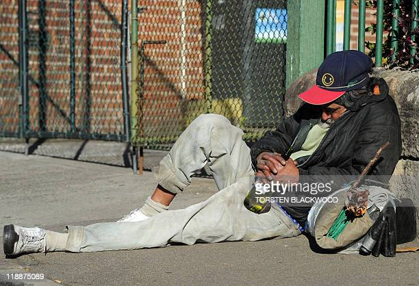 An unemployed homeless man sleeps on the pavement in Sydney's historic area known as The Rocks on July 12 2011 While Australia's unemployment rate...