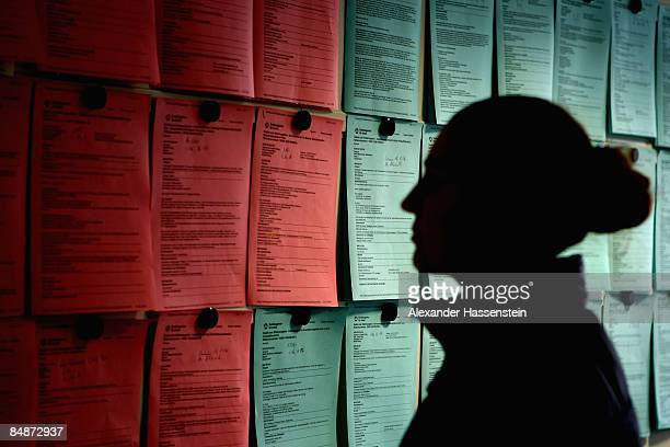 An unemployed person views job vacancies at the Unemployment agency on February 13 2009 in Erding Germany