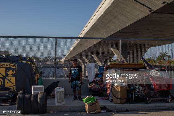 An unemployed upholsterer Israel Yaxon 28 yearsold who has lived for one year on the street stands outside his tent over the bridge of the 110...