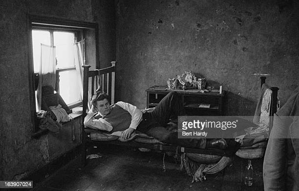 An unemployed youth in his room Liverpool 4th March 1957 Original publication Picture Post 8859 The Truth About Teenagers pub 18th March 1957