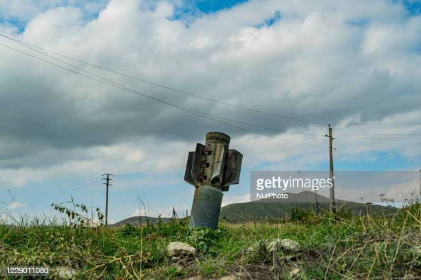 An unexploded azeri rocket nailed on the ground near Martuni village after being shelled by the Azerbaijan army during the clashes with Nagorno...