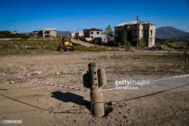 An unexploded BM-30 Smerch missile is seen on the outskirts of Stepanakert on October 12 during the ongoing military conflict between Armenia and...