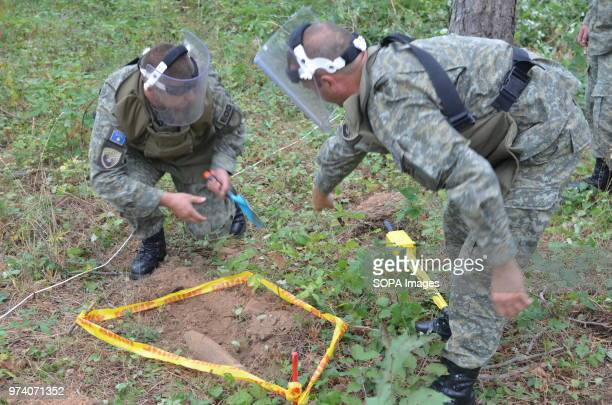 An unexploded shell is outlined with tape during a clearance operation by the Kosovo Security Force Emergency Ordinance Disposal team in Freedom Park...