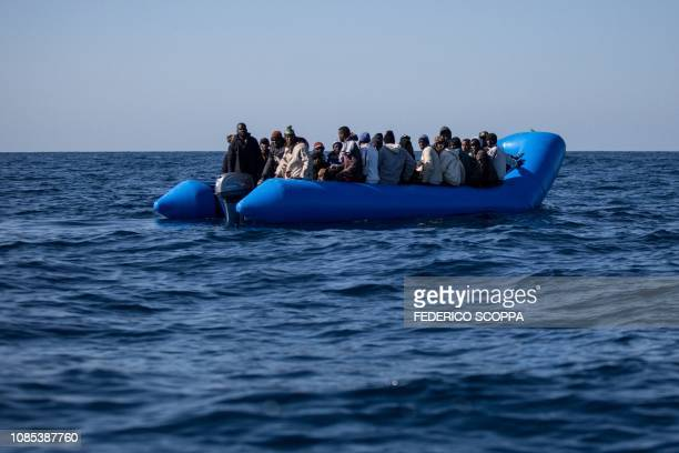 An unflatable boat with 47 migrants on board is pictured while being rescued by the Dutchflagged Sea Watch 3 off Libya's coasts on January 19 2019...