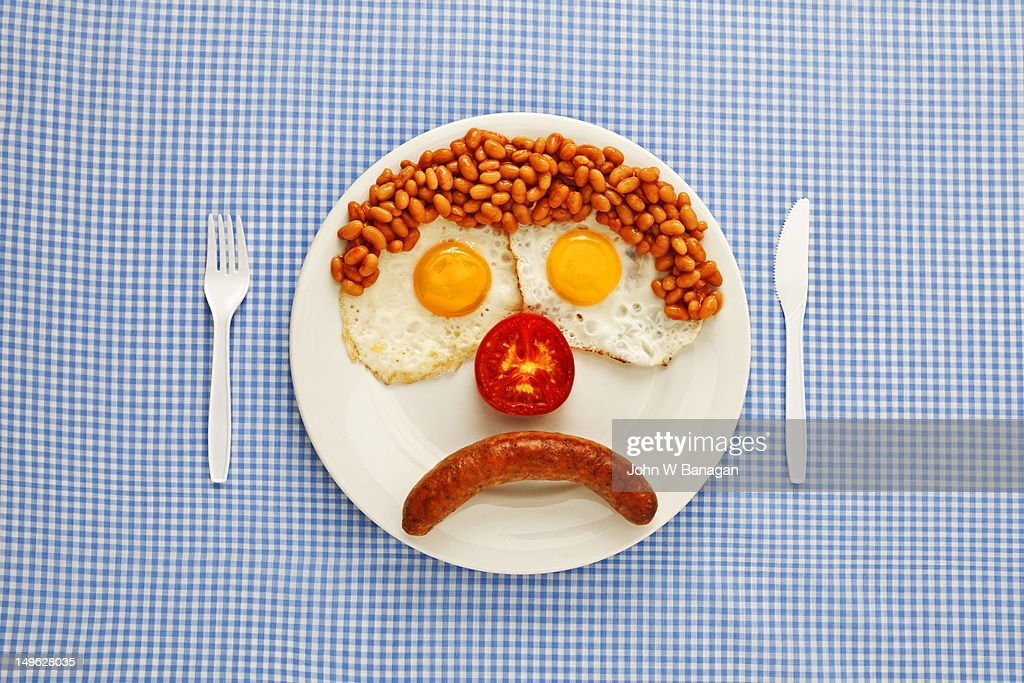 An unhappy fast-food breakfast : Stock Photo