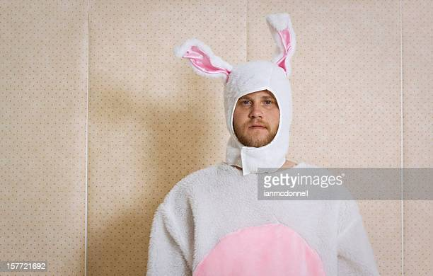 An unhappy man, dressed in a bunny outfit